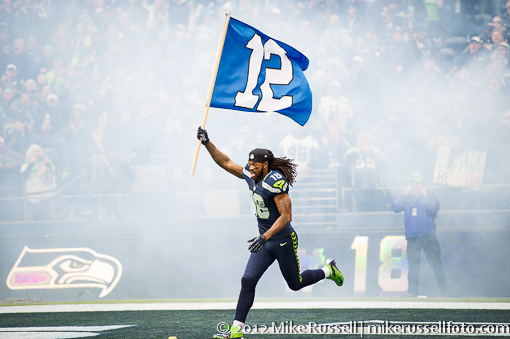 Seattle Seahawk Sidney Rice runs onto the field with the 12th man flag